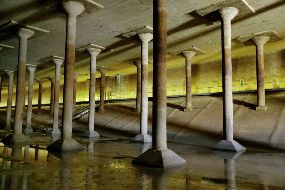 The Buffalo Bayou Park Cistern in Houston, bulit in 1926 to hold drinking water, contains hundreds of columns. (Melissa Phillip / Houston Chronicle) Photo: Melissa Phillip, MBI / Houston Chronicle