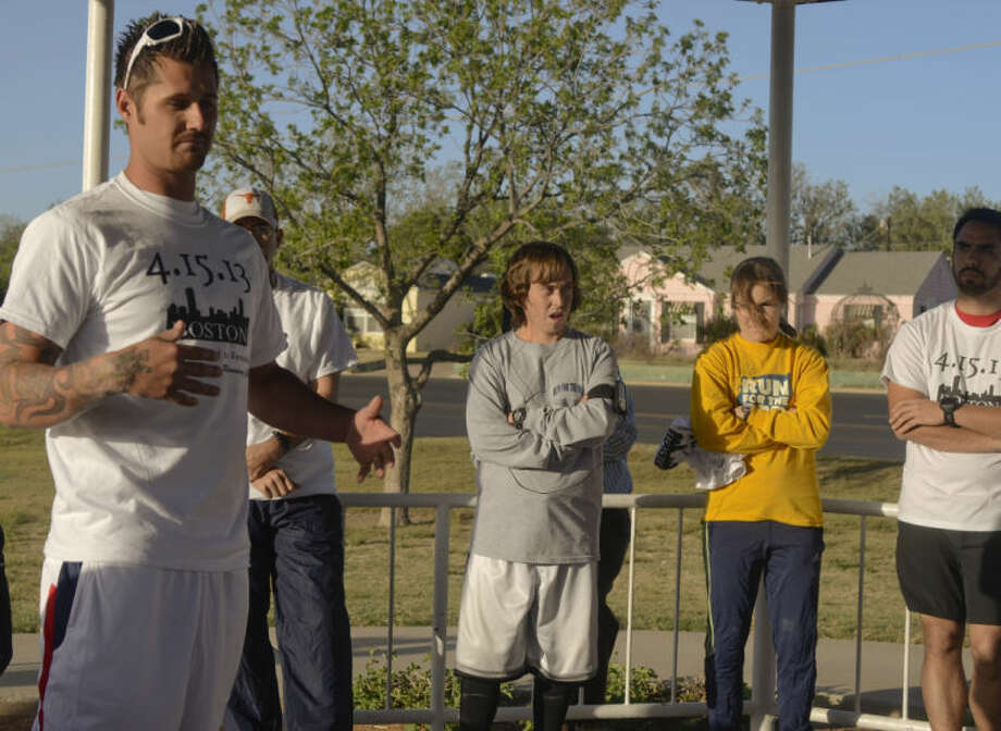 Jim Bob Bizzell, 2012 Paralympic track and field athlete from Odessa, talks with runners of the Permian Basin Running Club Thursday leading a silent lap around Wadley Barron Park in honor of the victims at the Boston Marathon. Tim Fischer\Reporter-Telegram 4-18-13 Tim Fischer\Reporter-Telegram Photo: Tim Fischer