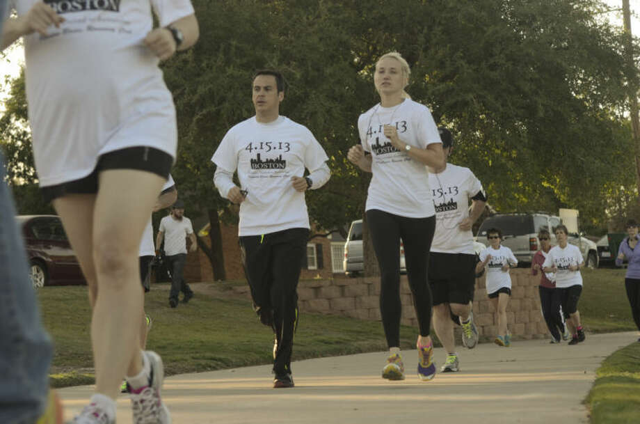 Members of the Permian Basin Running Club run a silent lap Thursday around Wadley Barron Park in honor of the victims at the Boston Marathon. Tim Fischer\Reporter-Telegram 4-18-13 Photo: Tim Fischer