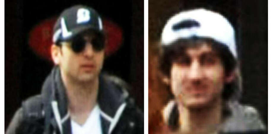 This combo of photos released by the FBI early Friday April 19, 2013, shows what the FBI is calling suspects number 1, left, and suspect number 2, right, walking through the crowd in Boston on Monday, April 15, 2013, before the explosions at the Boston Marathon. (AP Photo/FBI) Photo: Uncredited