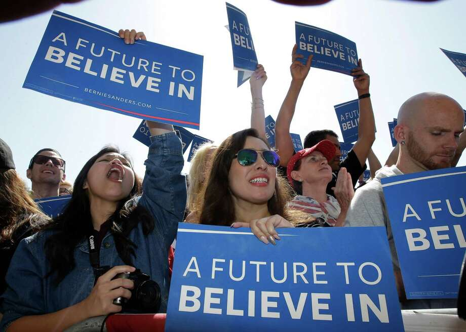 Supporters of Democratic presidential candidate Sen. Bernie Sanders, of Vermont, cheer for their candidate as he speaks during a campaign rally Tuesday in Stockton, Calif. (AP Photo / Rich Pedroncelli) Photo: Rich Pedroncelli, STF / Copyright 2016 The Associated Press. All rights reserved. This material may not be published, broadcast, rewritten or redistribu
