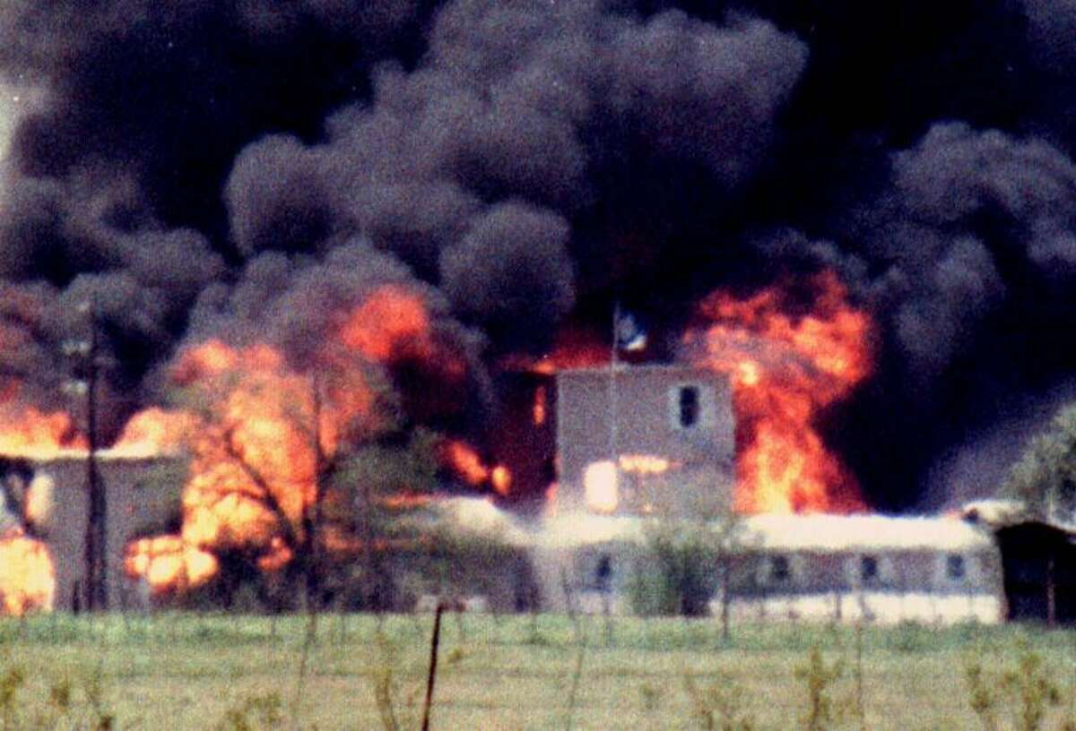 Rod Aydelotte Flames engulf the Branch Davidian compound April 19, 1993 near Waco Texas. More than 76 cult members including 21 children died in the fire as the 10th anniversary approaches. Remaining Davidians still hold a religious service each week on the grounds in a one-room chapel built by volunteers a few years ago.