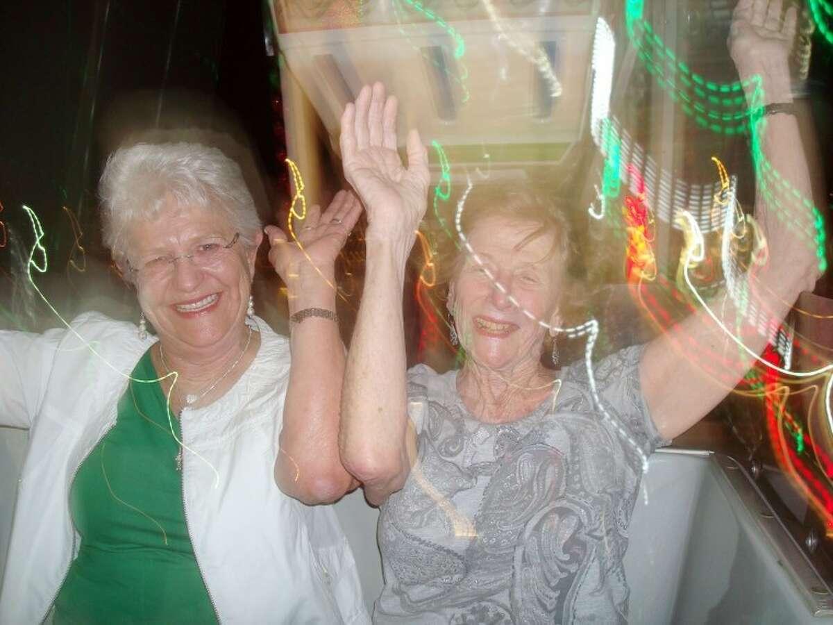 Linda Sauls, 70 and Pat Schneider, 85 take a late-night Ferris wheel ride.Shanna Sissom/Reporter-Telegram