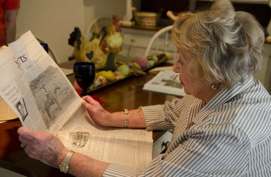 Jean Longman-Flint reads over an article from the 1970's about her grandfather, C.O. Finley killing a grizzly bear in the Alpine region of Texas in the 1890's. Photo by Tim Fischer/Midland Reporter-Telegram Photo: Tim Fischer