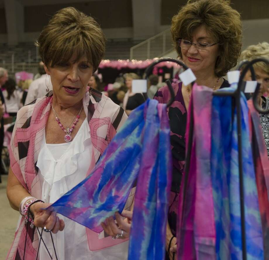 Mary Jane Wright and Ruthann Clayton look over some of the scarves available at the silent auction Tuesday during the 5th annual Laura W. Bush Institute for Women's Health luncheon. Photo by Tim Fischer/Midland Reporter-Telegram Photo: Tim Fischer