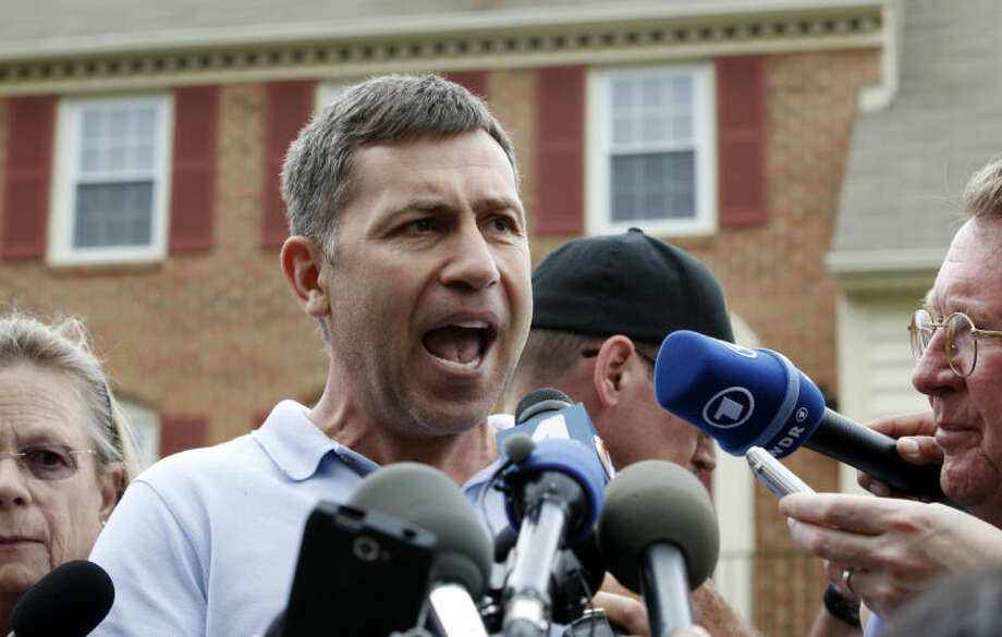 Ruslan Tsarni, the uncle of the Boston Marathon bombing suspect, speaks with the media outside his home in Montgomery Village in Md. Friday, April, 19, 2013. Tsarni urged his nephew to turn himself in. (AP Photo/Jose Luis Magana) Photo: Jose Luis Magana