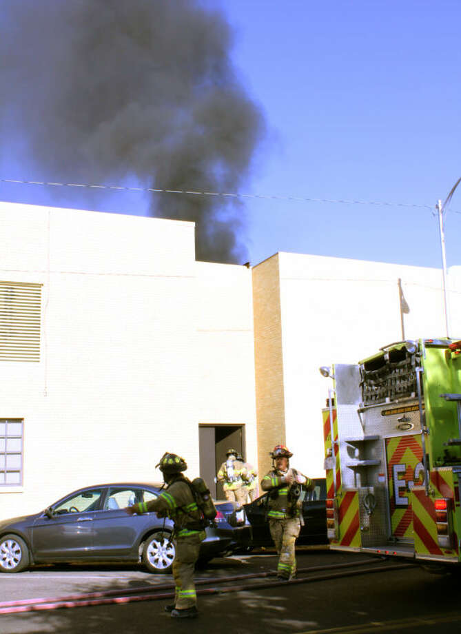 Midland firefighters respond to smoke at First Methodist Church Friday morning. Photo by Meridith Moriak/MRT