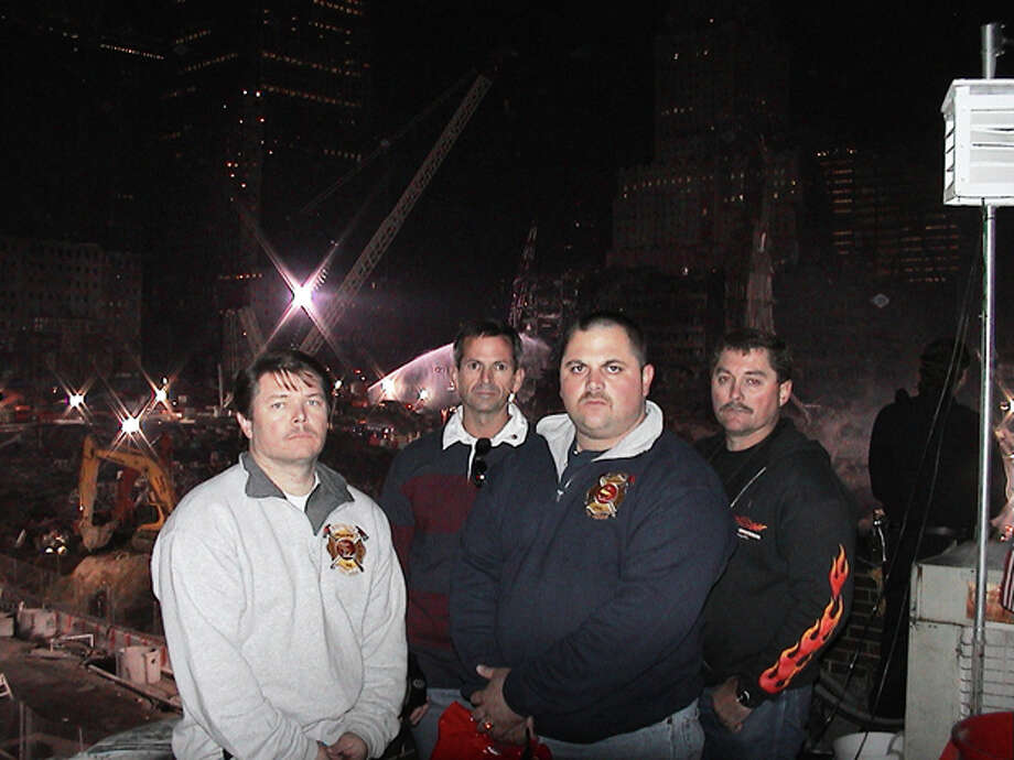 Midland Fire Chief Robert Isbell (left) poses with members of the South Lake (Texas) Fire Department in front of Ground Zero in New York in November 2011. Isbell was fire chief with the South Lake FD at the time of the attacks and was part of a crew from the department which volunteered their time to honor New York firefighters killed in the attacks. Photo: Courtesy MFD Chief Robert Isbell