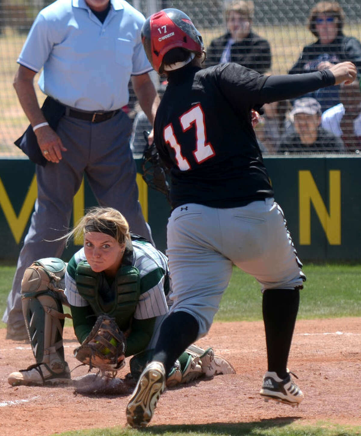 Midland College catcher Amy Anderson tags out Howard College's Elizabeth Torres at home plate Friday at the Midland College softball field. James Durbin/Reporter-Telegram
