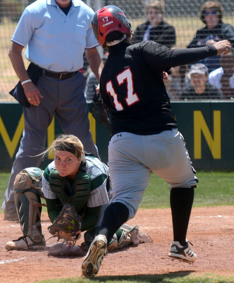 Midland College catcher Amy Anderson tags out Howard College's Elizabeth Torres at home plate Friday at the Midland College softball field. James Durbin/Reporter-Telegram Photo: JAMES DURBIN