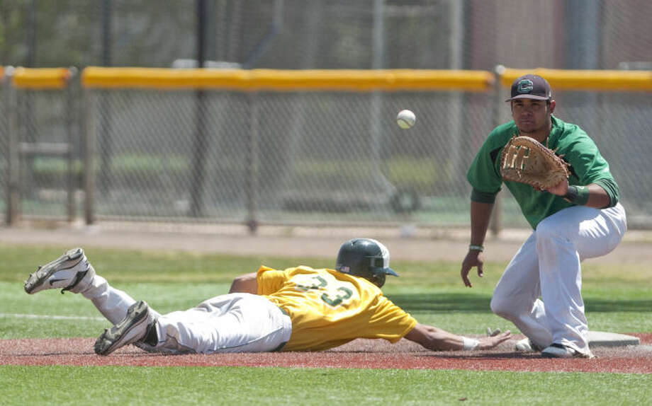 Midland College's Chris Shaw slides back to first as Clarendon's Richard Ramirez tries to pick him off Saturday at Christensen Stadium. James Durbin/Reporter-Telegram Photo: JAMES DURBIN