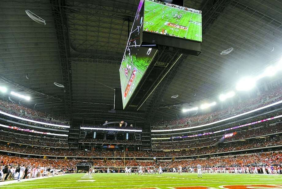 Billy Calzada/Hearst News Service COOL PLACE TO PLAY Cowboys Stadium will likely host the College Football Playoff national championship game in January of 2015. Photo: BILLY CALZADA