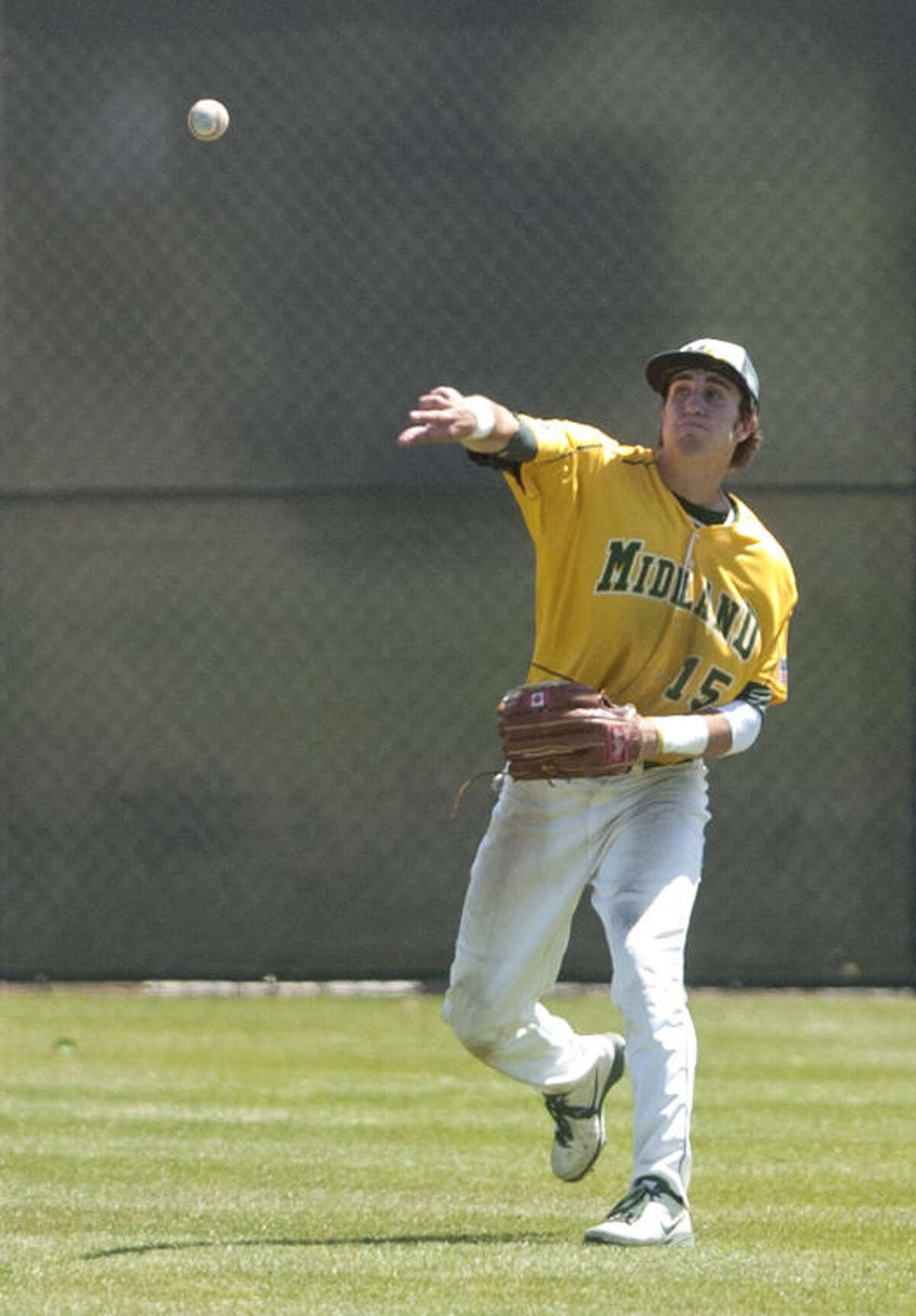 Midland College's Jeremie Fang throws to second base after recovering a ground ball during the game against Clarendon Saturday at Christensen Stadium. James Durbin/Reporter-Telegram