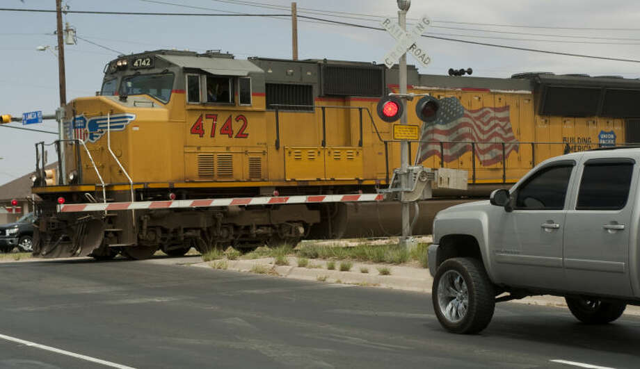 Midland Police team with Union Pacific RR Tuesday afternoon to promote safety at railroad crossings. Tim Fischer\Reporter-Telegram Photo: Tim Fischer