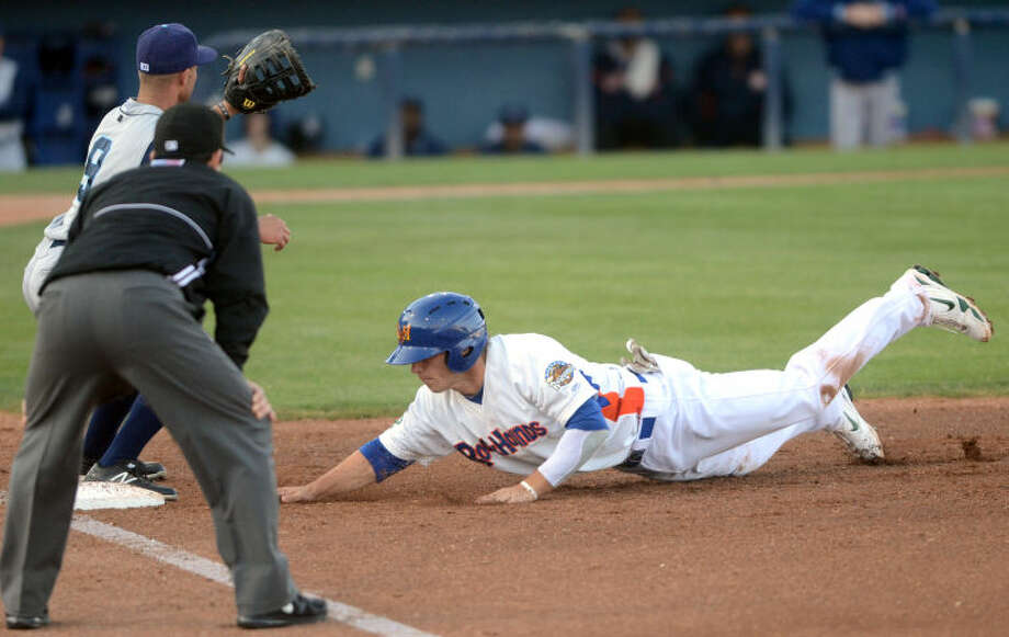 RockHounds' Dusty Coleman beats the pick-off attempt at first base during the game against Corpus Christi Wednesday at Citibank Ballpark. James Durbin/Reporter-Telegram Photo: JAMES DURBIN