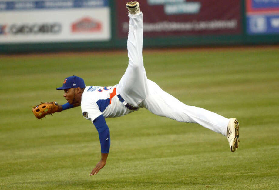 RockHounds' right fielder Jeremy Barfield loses his footing after attempting a long throw to home plate during the game against Corpus Christi Wednesday at Citibank Ballpark. James Durbin/Reporter-Telegram Photo: JAMES DURBIN