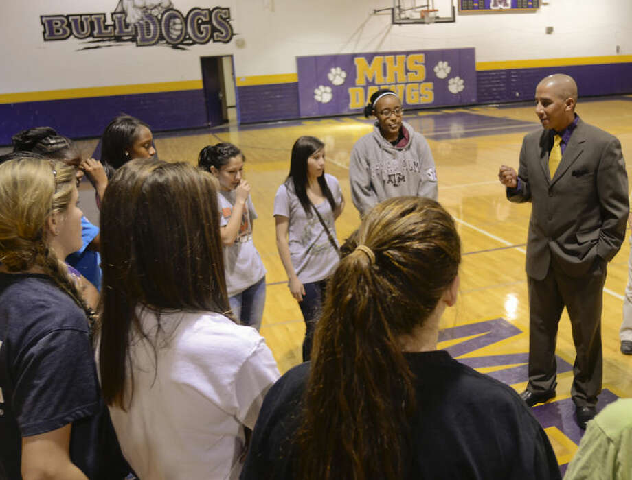 Midland High's new girls head basketball coach Wes Torres talks with his players Monday following his official introduction to the Midland High family. Tim Fischer\Reporter-Telegram Photo: Tim Fischer