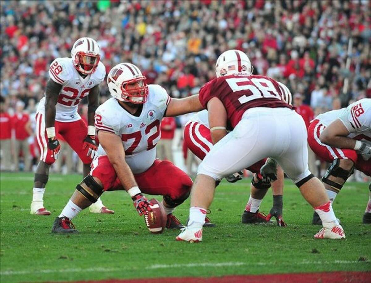 Wisconsin center Travis Frederick (72) prepares the snap the ball in a game from the 2012-13 season. AP photo