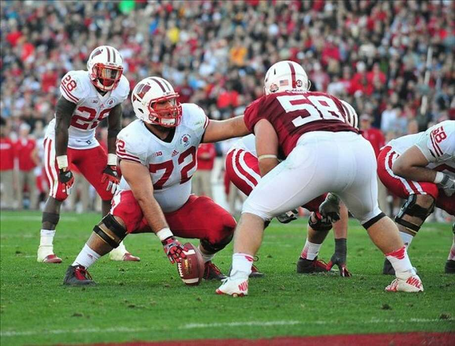 Wisconsin center Travis Frederick (72) prepares the snap the ball in a game from the 2012-13 season. AP photo Photo: AP Photo