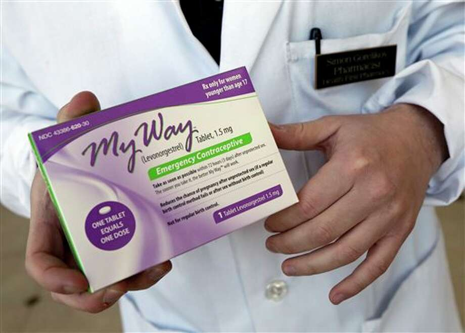 FILE - In this May 2, 2013 photo, pharmacist Simon Gorelikov holds a generic emergency contraceptive, also called the morning-after pill, at the Health First Pharmacy in Boston. The Obama administration on Monday, May 13, 2013 filed a last-minute appeal to delay the sale of the morning-after contraceptive pill to girls of any age without a prescription. (AP Photo/Elise Amendola, File) Photo: Elise Amendola / AP