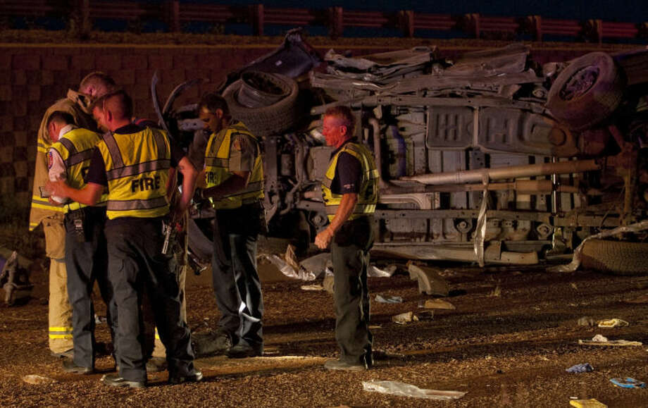 A one vehicle accident sent the driver to MMH Monday evening after she overcorrected on entering Loop 250 at Lamesa and jumped the guard rail and rolled her Ford truck down onto the north service road. Tim Fischer\Reporter-Telegram Photo: Tim Fischer