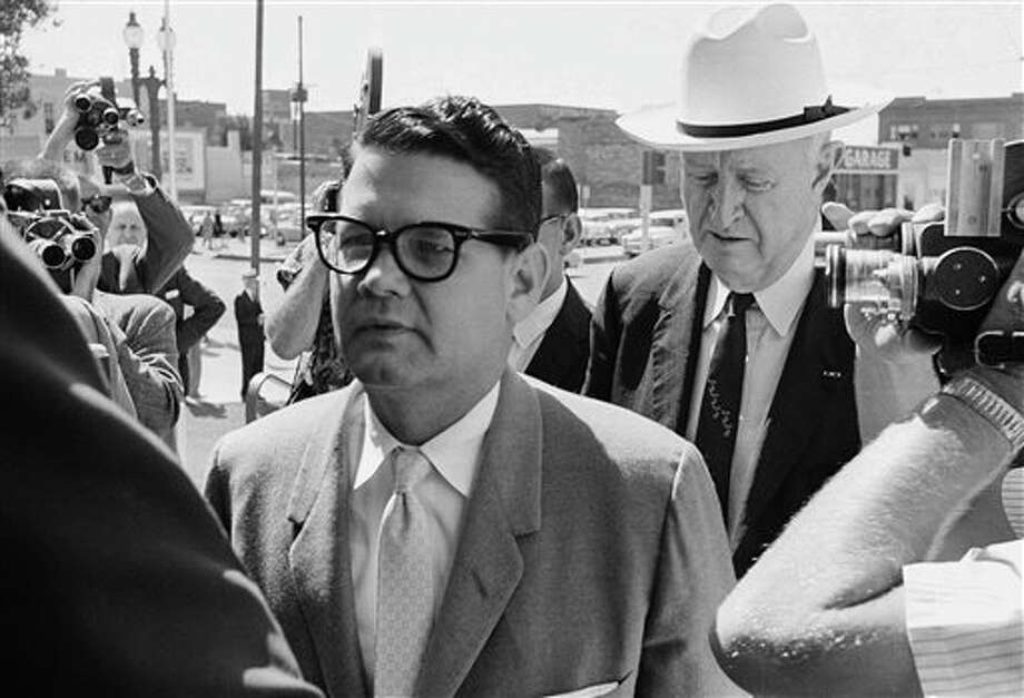 FILE - In this May 23,1962 file photo, Billie Sol Estes, left, and his attorney John Cofer of Austin, Tex. are shown as they arrived at the federal court house in El Paso, Texas. Estes, the flamboyant Texas huckster and con man, has died at age 88. Hood County Sheriff Roger Deed says Estes was found dead in his home in Hood County, Texas, by a caregiver early Tuesday, May 14, 2013. (AP Photo/Ferd Kaufman, File) Photo: Ferd Kaufman / AP