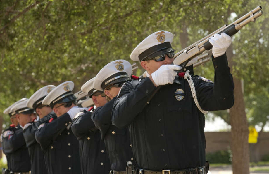 Members of Midland Police Honor Guard fire a 21 gun volley salute Wednesday during the memorial for Texas officers who lost their lives last year. Tim Fischer\Reporter-Telegram Photo: Tim Fischer
