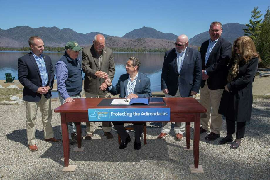 Gov.  Andrew M. Cuomo, center, announced the completion of the state's largest Adirondack land acquisition in more than 100 years, with the purchase of the 20,758-acre Boreas Ponds Tract on May 10, 2016, in North Hudson, N.Y.  (Office of the Governor) Photo: Philip Kamrass / Office of Governor Andrew M. Cuomo
