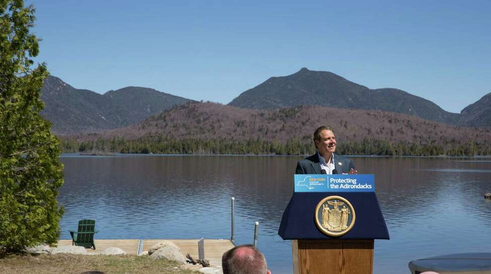 Gov. Andrew M. Cuomo, center, announced the completion of the state?'s largest Adirondack land acquisition in more than 100 years, with the purchase of the 20,758-acre Boreas Ponds Tract on May 10, 2016, in North Hudson, N.Y. (Office of the Governor)