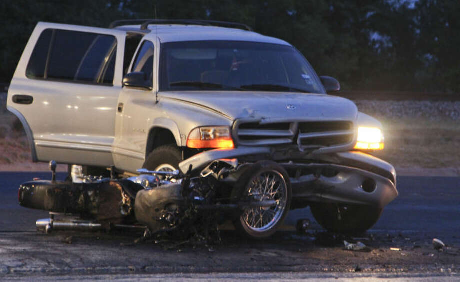 A motorcyclist was killed after colliding with a turning SUV Saturday night near the intersection of Front Street and Fairgrounds Road. The SUV driver fled the scene on foot before being caught by police. Tyler White/Reporter-Telegram Photo: Tyler White