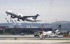 FILE - In this July 25, 2013, file photo, a United Airlines plane, top left, takes off from Newark Liberty International Airport, in Newark, N.J. United Continental says its President and CEO Oscar Munoz will return to his roles full time later in March 2016. Munoz took medical leave after suffering a heart attack in October 2015, just six weeks after replacing Jim Smisek as CEO. He then had a heart transplant in January. (AP Photo/Julio Cortez, File)