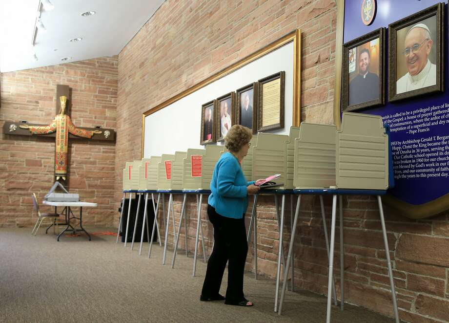 Mary Ann Herring works on her ballot at a polling station at Christ the King Church in Omaha, Neb., Tuesday, May 10, 2016, during the Nebraska primary election. (AP Photo/Nati Harnik) Photo: Nati Harnik, Associated Press