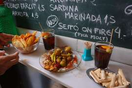 Standing at a bar with a sampler of tapas and chalkboard specials on the wall is a quintessential Spain experience.