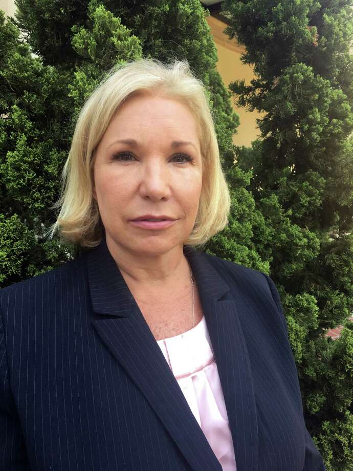 """HOLD FOR STORY BY TAMARA LUSH-In this photo taken Monday, May 9, 2016, Ami Forte a former broker at Morgan Stanley is seen in St. Peterburg, Fla. Forte has filed an arbitration case against her former employer, Morgan Stanley. The bank fired her after the Financial Industry Regulatory Agency said that Forte and the company """"took advantage"""" of the Ron Speer, the founder of the Home Shopping Network and a billionaire. (AP Photo/Tamara Lush) Photo: Tamara Lush, STF / Copyright 2016 The Associated Press. All rights reserved. This material may not be published, broadcast, rewritten or redistribu"""