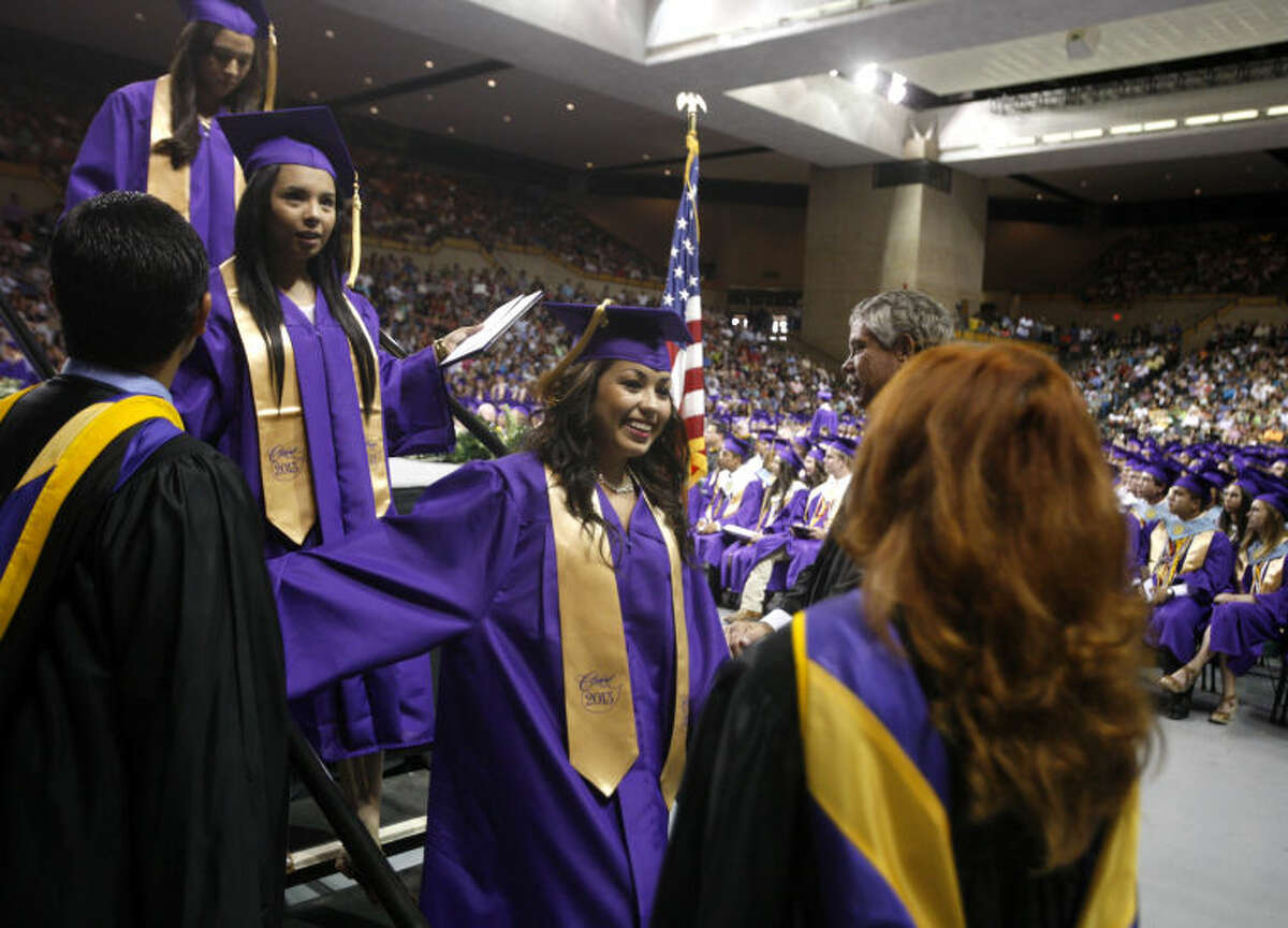 Midland High graduates walk across the stage during the graduation ceremony Saturday at Chaparral Center. James Durbin/Reporter-Telegram