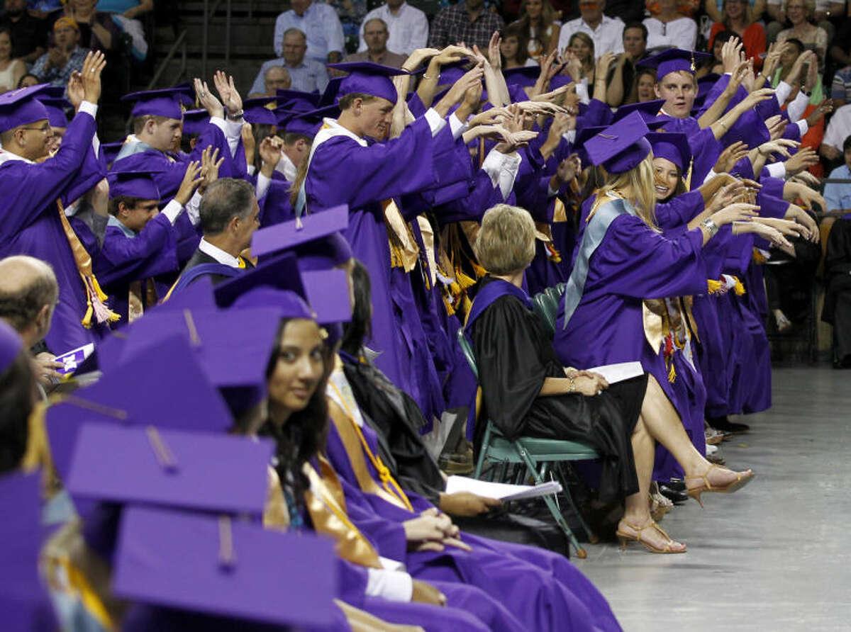Midland High seniors do a wave during the graduation ceremony Saturday at Chaparral Center. James Durbin/Reporter-Telegram