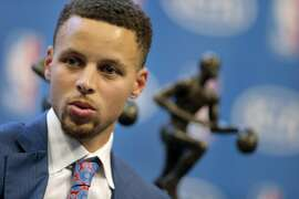 Stephen Curry waits on stage for a live interview with his two MVP trophies behind him following a ceremony where he was awarded the 2016 Kia NBA Most Valuable Player award during ceremony at Oracle Arena in Oakland, Calif., on Tuesday, May 10, 2016.