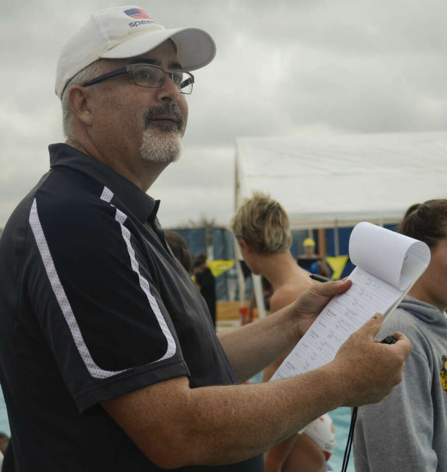 COM coach Bob Kizer keeps at watchful eye on his swimmers Friday at the Western National Bank Invitational. Tim Fischer\Reporter-Telegram Photo: Tim Fischer