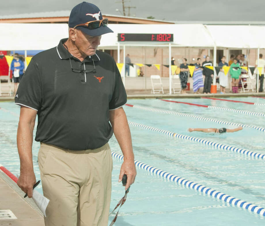 Former Olympian and Midlander, Doug Russell, coaches his swimmers with Longhorn Aquatics Team Friday during the Western National Bank Invitational at his namesake, Doug Russell Pool. Tim Fischer\Reporter-Telegram Photo: Tim Fischer