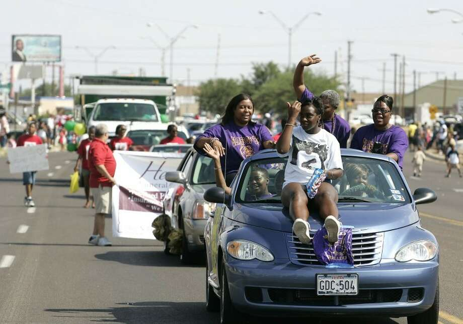 (File Photo) Members of the Midland High Class of 1988 wave to the crowd as the 2008 Juneteenth Parade progresses down Lamesa Road. Photo: Gary Rhodes