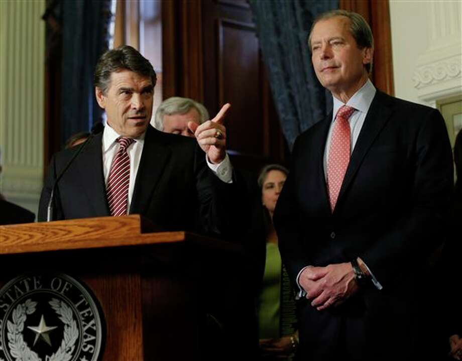 (File Photo) Gov. Rick Perry, left, and Lt. Governor David Dewhurst, right, during a ceremonial signing of a water fund bill, Tuesday, May 28, 2013, in Austin, Texas. The legislative session ended Monday, but Perry immediately called lawmakers back for a special session. They have 30 days to approve new voting maps, though the governor will likely add more items to the agenda. (AP Photo/Eric Gay) Photo: Eric Gay / AP
