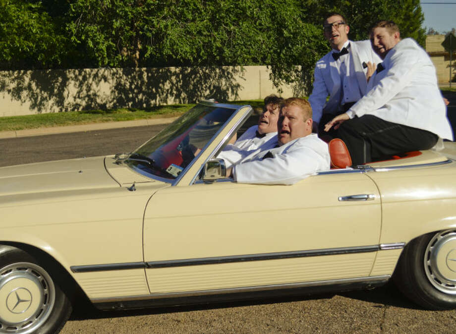 Scott Windham, driving, as Francis, Brian Gravelle, passenger as Jinx, Danny Anderson as Sparky and Drew Henry as Smudge, react as their car is hit by a bus full of nuns in MCT's production of Forever Plaid. Tim Fischer\Reporter-Telegram Photo: Tim Fischer