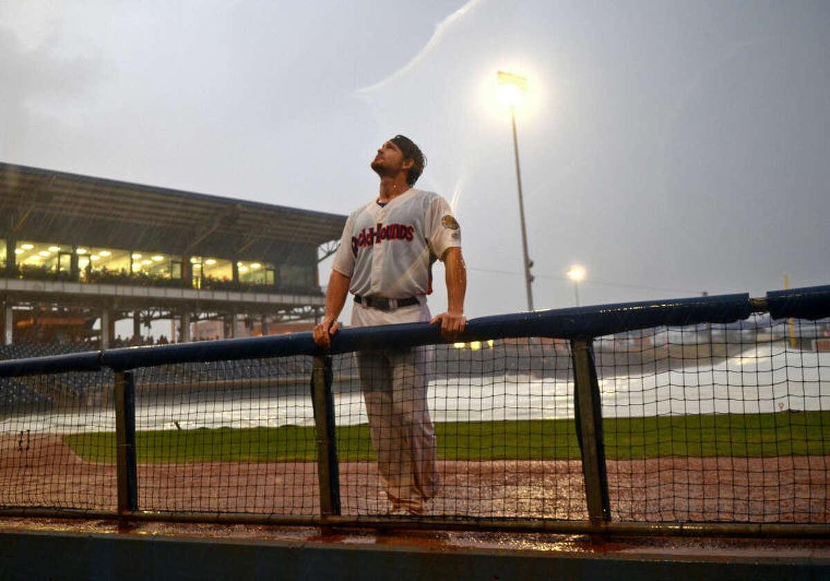 RockHounds catcher Ryan Lipkin rides out a storm that delayed the RockHounds vs San Antonio Missions game Thursday at Citibank Ballpark. James Durbin/Reporter-Telegram