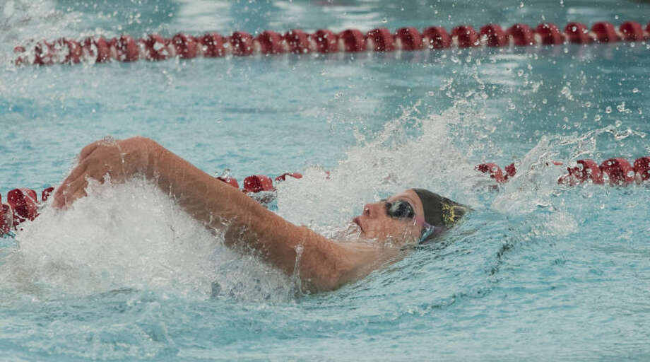 COM's Lindsay Helferich swims Friday in the girls 13 and over 100 m backstroke at the Western National Bank Invitational at Doug Russell Pool. Tim Fischer\Reporter-Telegram Photo: Tim Fischer