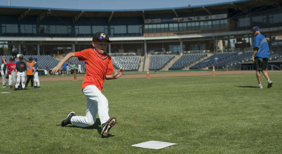 Toby Delk makes a slide into second as he and others participate in the RockHounds Kids Camp at CitiBank Ballpark. Tim Fischer\Reporter-Telegram Photo: Tim Fischer