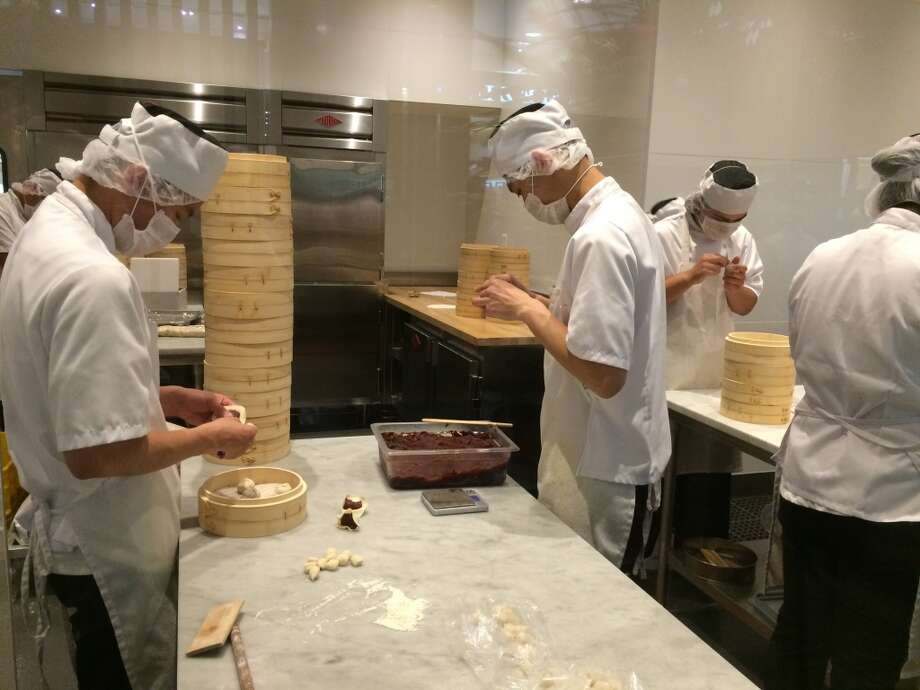 Dumpling production is showcased at the entrance of Din Tai Fung, giving hungry diners a peek at what is in store (once they're able to get a seat). Photo: Sarah Fritsche
