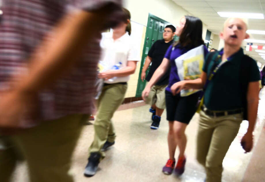 San Jacinto Junior High students walk through the hallway after school Wednesday. James Durbin/Reporter-Telegram Photo: JAMES DURBIN