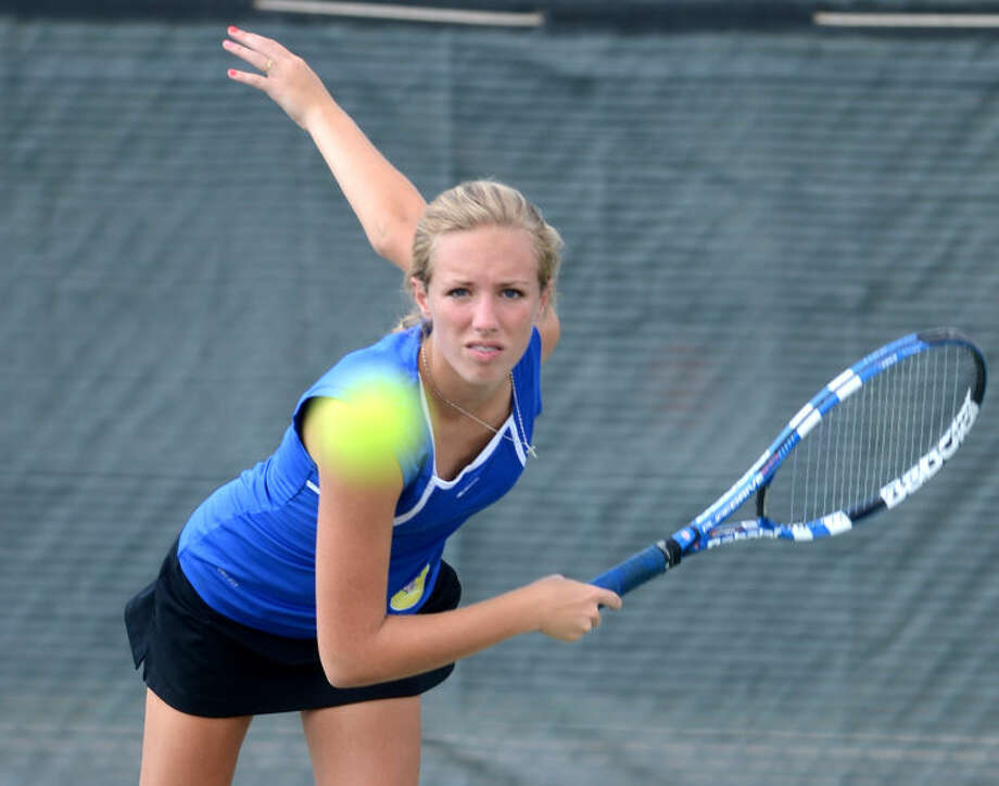 Midland Christian's Makenzi Stubbs hits during a doubles match against Midland High on Thursday at the Midland High Tennis Center. James Durbin/Reporter-Telegram Photo: JAMES DURBIN