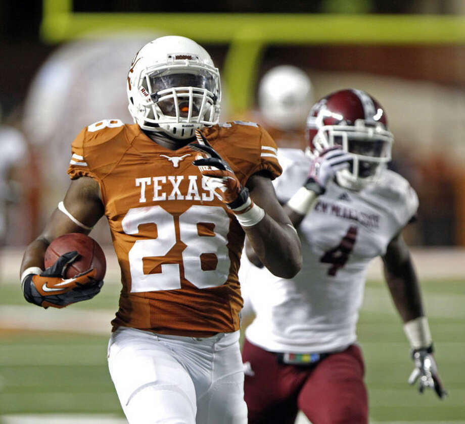 Texas running back Malcolm Brown (28) runs for a touchdown after catching a short pass against New Mexico State cornerback Darien Johnson during the third quarter of an NCAA college football game, Saturday Aug. 31, 2013, in Austin, Texas. (AP Photo/Michael Thomas) Photo: Michael Thomas