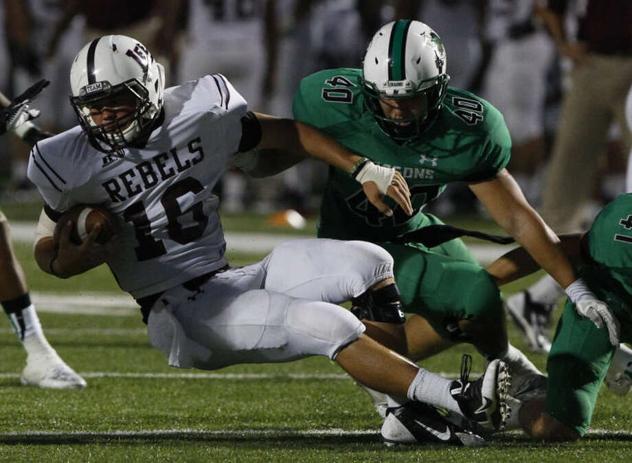 Lee quarterback Caden Coots (16) is brought down by Southlake Carroll's Steven Bergmark (40) and JB Copeland (41) Friday. (Star-Telegram/ Richard W. Rodriguez) Photo: Richard W. Rodriguez